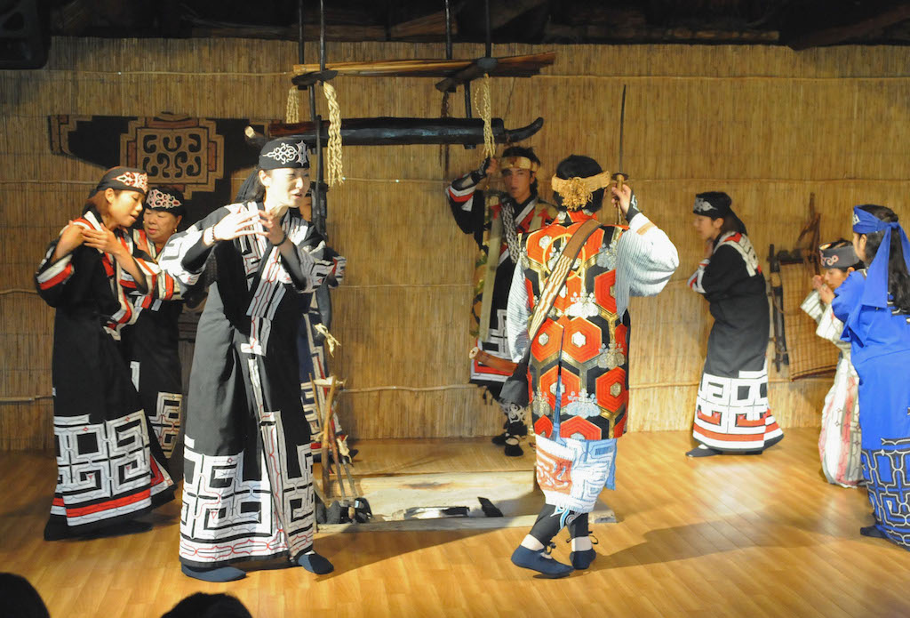 TO GO WITH STORY JAPAN-POLITICS-RIGHTS-MINORITY, FEATURE BY KYOKO HASEGAWA In this photograph taken on July 11, 2012, Japan's indigenous Aibu people show their folk dancing at Nibutani Ainu Suseum at Biratori in Japan's northern island of Hokkaido at Biratori in Japan's northern island of Hokkaido. Shiro Kayano, president of Nibutani Ainu Museum, whose ambitious bid to win 10 parliamentary seats for the newly created Ainu Party in next year's national elections, as well as vast land claims for his people, is the latest move aimed at boosting recognition for what was once a hunter-gatherer society in Japan's northernmost Hokkaido.  AFP PHOTO / Toshifumi KITAMURA